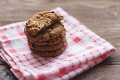 Delicious crispy oatmeal cookies with chocolate chips on a napkin.  royalty free stock images