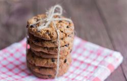 Delicious crispy oatmeal cookies with chocolate chips on a napkin.  stock photos