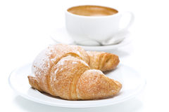 Delicious croissant and cup of black coffee, close-up Royalty Free Stock Images