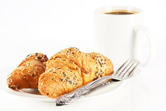Delicious croissant with a cup of black coffee Royalty Free Stock Images