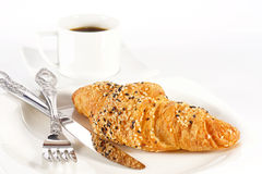 Delicious croissant with a cup of black coffee Stock Image