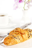Delicious croissant with a cup of black coffee Stock Images
