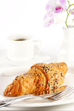 Delicious croissant with a cup of black coffee Royalty Free Stock Photos