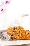 Delicious croissant with a cup of black coffee Royalty Free Stock Photo