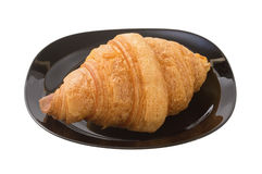 Delicious croissant on a dark plate.  royalty free stock photography