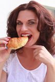 Delicious croissant with a pretty woman to attach Royalty Free Stock Image