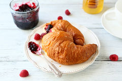 Delicious croissant with raspberries and jam. Food Stock Images