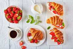 Croissant sandwiches with fresh ripe strawberries Stock Image