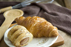 Delicious croissant and sausage roll Stock Photo