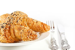 Delicious croissant on white plate Royalty Free Stock Photography