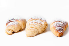 Delicious croissants against a white background Stock Photos