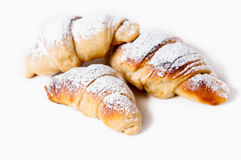 Delicious croissants against a white background Stock Images