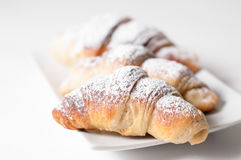 Delicious croissants against a white background Stock Photo