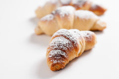 Delicious croissants against a white background Stock Image