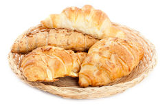 Delicious croissants in a basket. On white Stock Images