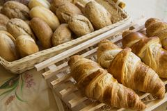 Delicious  Croissants and buns. Croissants breakfast in served table Royalty Free Stock Photos