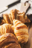 Delicious croissants on wooden board Stock Photography