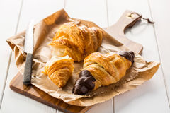 Delicious croissants on wooden board Stock Images