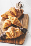 Delicious croissants on wooden board Royalty Free Stock Images