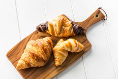 Delicious croissants on wooden board Stock Image