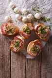 Delicious crostini with bacon and mozzarella cheese. vertical to Royalty Free Stock Photography
