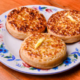 Delicious crumpets covered in melting butter Stock Photo