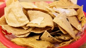 Delicious Totopos or hard tortilla chips. Typical traditional Mexican food. Delicious crunchy Totopos or hard tortilla chips. Typical traditional Mexican food royalty free stock images