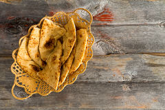 Delicious crusty naan flatbread slices in a basket Stock Photos