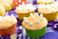 Delicious cup cakes. Creamy and delicious cup cakes or muffins, a delightful fresh bakery product Stock Photography