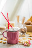 A delicious Cup of cocoa with marshmallows and straws Stock Images