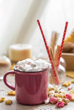 A delicious Cup of cocoa with marshmallows and straws Royalty Free Stock Image