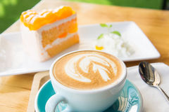 Delicious cup of coffee aromatic and delicious cakes. Royalty Free Stock Image