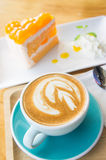 Delicious cup of coffee aromatic and delicious cakes. Stock Photography