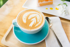 Delicious cup of coffee aromatic and delicious cakes. Royalty Free Stock Photo