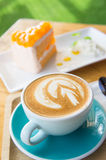 Delicious cup of coffee aromatic and delicious cakes. Stock Images