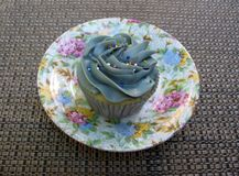 Delicious cupcake on a beautiful source Stock Images