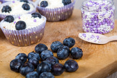 Delicious cupcake with blueberries, cream and fresh berries Royalty Free Stock Photography