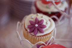 Delicious cupcake. S on table in a candy bar Royalty Free Stock Image