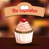 Delicious cupcake with dessert cherry and sugar powder Stock Photo