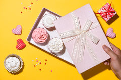 Delicious cupcake with paper box on yellow background Stock Photography