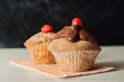 Delicious cupcake on table on dark background Royalty Free Stock Image