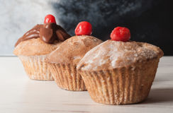 Delicious cupcake on table on dark background Stock Image