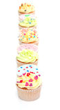 Delicious cupcakes. Some home made delicious cupcakes in a row Royalty Free Stock Photography