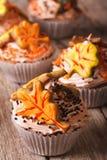 Delicious cupcakes in autumn style macro. vertical Stock Photo