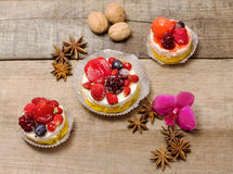 Delicious cupcakes with berries over wood Stock Images