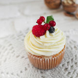 Delicious cupcakes with berries Stock Photos