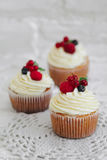 Delicious cupcakes with berries Stock Photo
