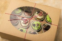 Delicious cupcakes in a box. Cupcakes with biscuits, figs, chocolate, marmalade. Stock Photos