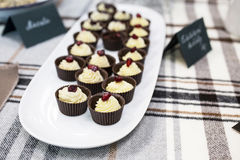 Delicious cupcakes with buttercream and fruits Royalty Free Stock Photo
