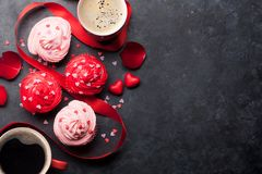 Delicious cupcakes and coffee cups stock photography